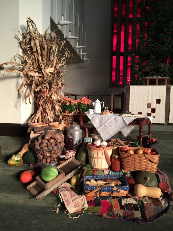 A bunch of Thanksgiving items arrayed on the church steps.